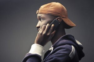 African-man-modern-dress-on-phone.jpg