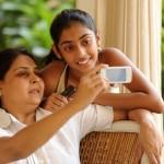 Indian-family-using-phone-smaller.jpg