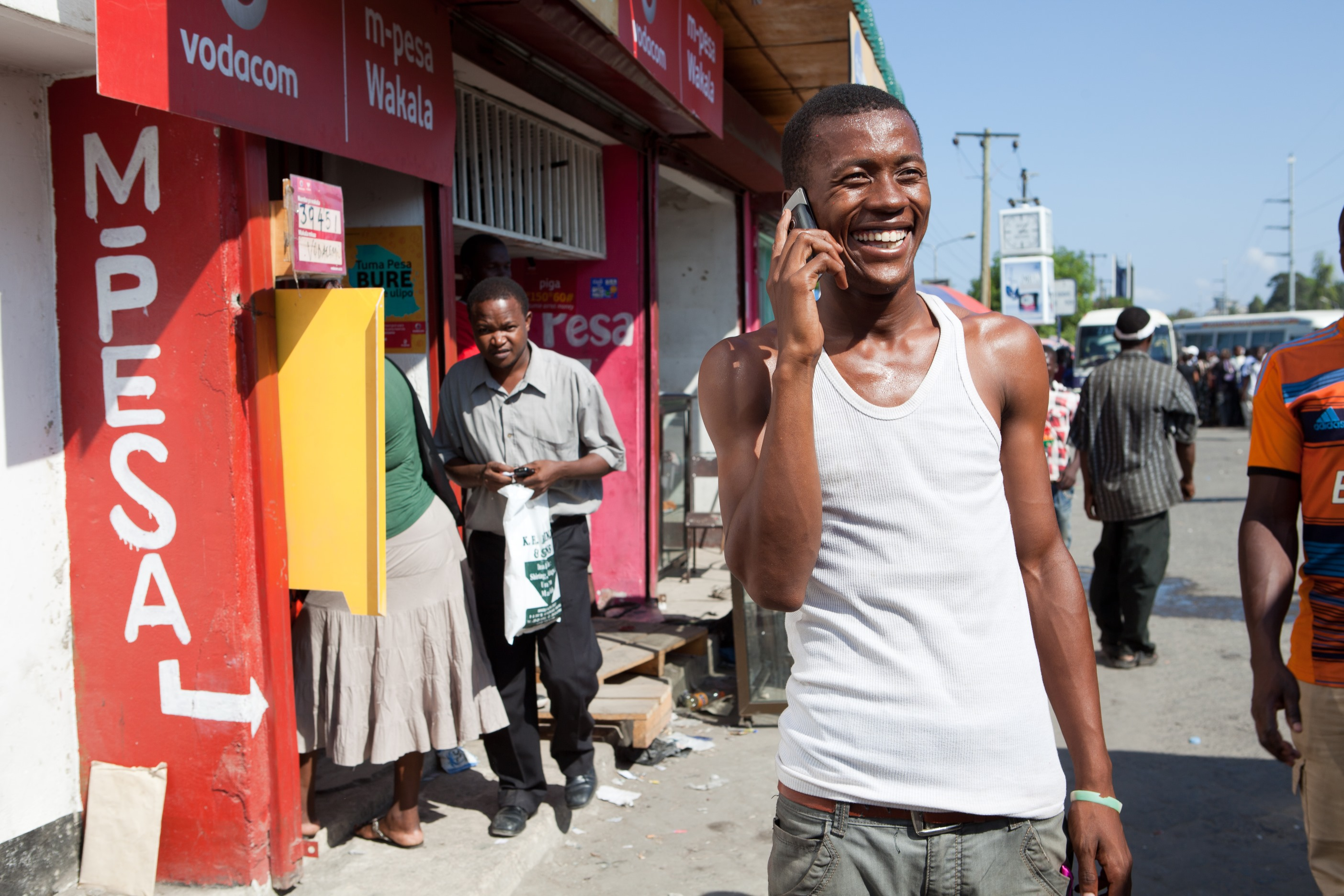 http://mobilemarketingmagazine.com/wp-content/uploads/2015/08/M-Pesa-Mobile-Money-User-Tanzania-Africa.jpg