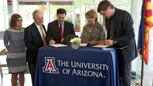 Gov. Doug Ducey, third left, signs an agreement with University of Arizona President Ann Weaver, second right, and Brian McClendon, the vice president for Uber which will allow them to the test and do research on driverless technology in the Tucson area, Tuesday, Aug. 25, 2015, in Tucson, Ariz. Rep Martha McSally, far left, and Mayor Jonathan Rothschild witnessed the signing. Ducey made the announcement at the University of Arizona Optical Sciences which will assist n the mapping and safety technology. (A.E. Araiza/Arizona Daily Star via AP) ALL LOCAL TELEVISION OUT; PAC-12 OUT; MANDATORY CREDIT; GREEN VALLEY NEWS OUT