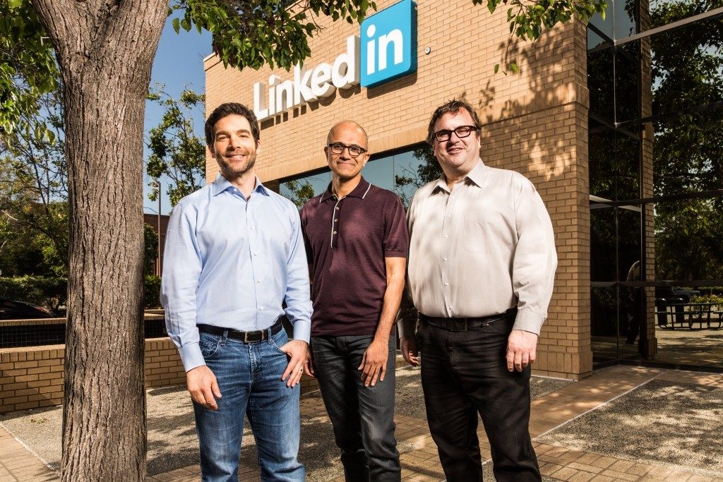 (L-R) Jeff Weiner, CEO of LinkedIn, Satya Nadella, CEO of Microsoft, and Reid Hoffman, chairman of the board at LinkedIn