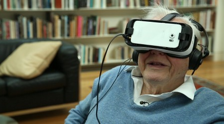 Sir David Attenborough uses a VR headset