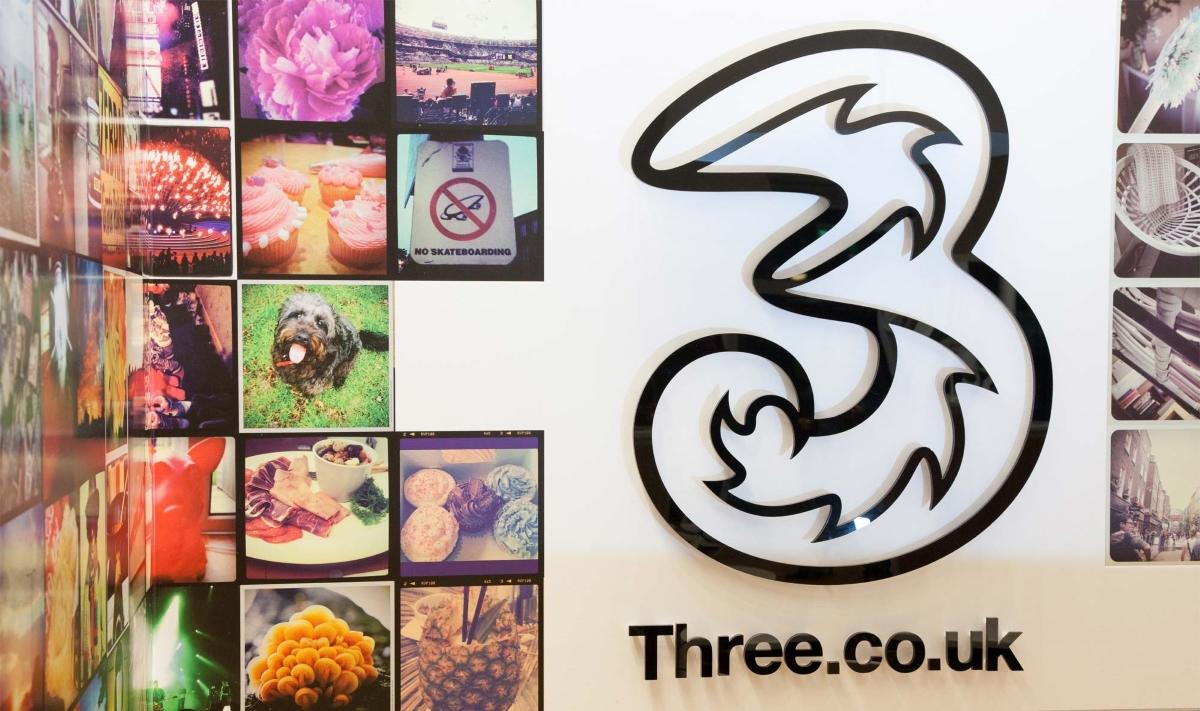 Three logo IRL store