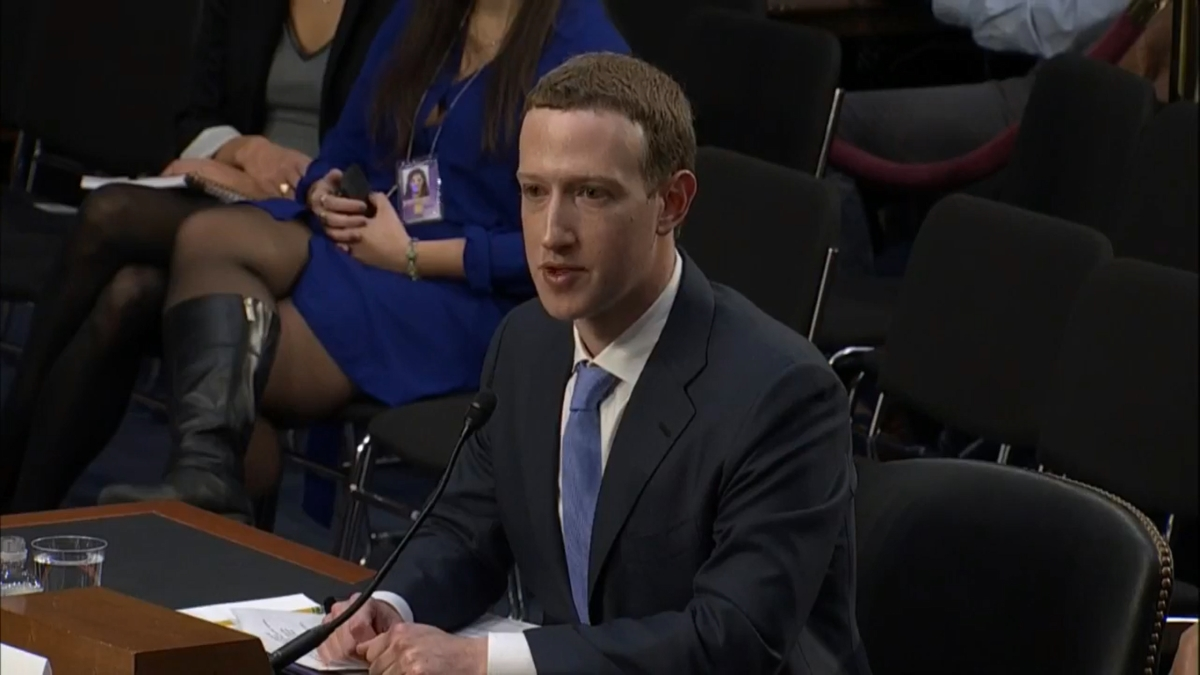 Mark Zuckerberg (pictured speaking in the US Senate) is under pressure from the UK, US, and Australian governments to halt Facebook's end-to-end encryption plans