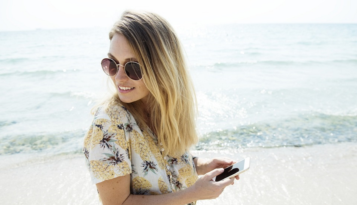 Woman mobile smartphone beach holiday
