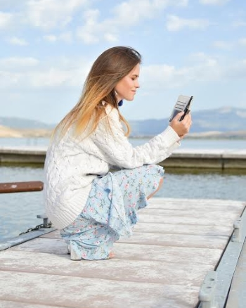Woman mobile smartphone pier