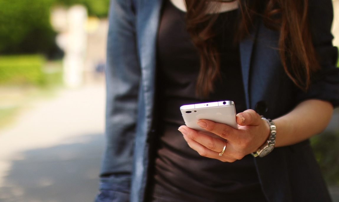 Woman with phone in hand