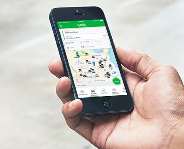 Toyota invests in Uber rival Grab, agrees data collaboration