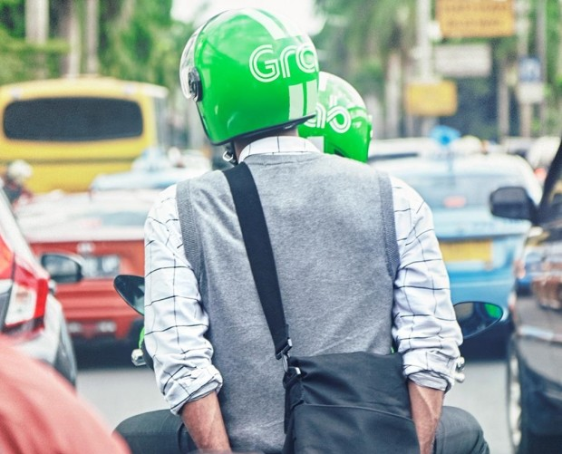 Asian taxi app Grab acquires payments firm Kudo as part of $700m investment in Indonesia