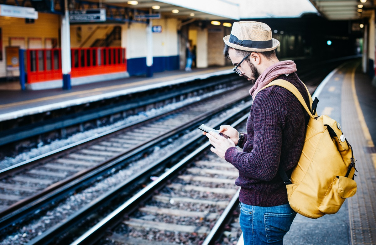Mobile smartphone man train station